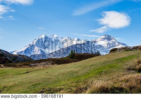 View Of Swiss Alps Mountain Of Valais, Wallis Near Rothwald On Sunny Day In Autumn, Blue Sky Cloud B