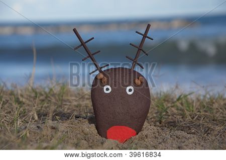 reindeer head painted on a stone, christmas object