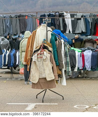 Vests And Winter Clothing Hanging On Rails At Flea Market