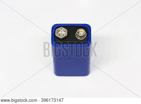 Detail Of The Positive And Negative Poles Of A Blue 9 Volt Battery Isolated On A White Background. E