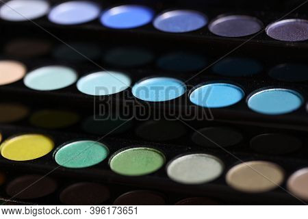 Close-up Of Colorful Cosmetic Eyeshadows. Multicolour Pallet For Professional Make-up Artist. Decora
