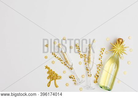 Festive White Background With Gold Decoration , Bottle Of Sparkling Wine With Two Crystal Glasses, S