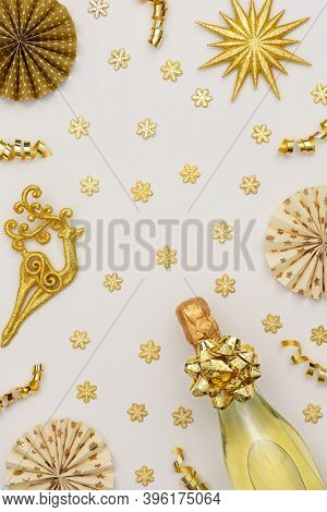Festive Background With Gold Decoration , Gift Boxes With Bottle Of Sparkling Wine, Shiny Golden Ser