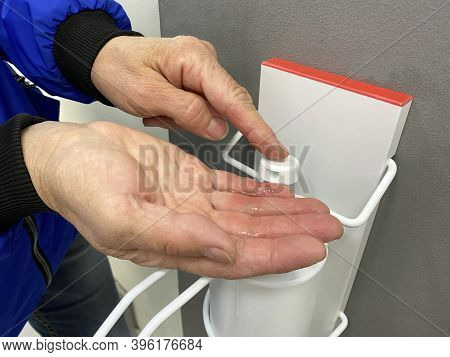 Hand Washing With Disinfectant Close-up. Elderly Woman Disinfects Her Hands With An Antiseptic Gel A