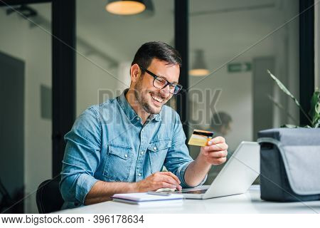 Happy Cheerful Smiling Young Adult Man Doing Online Shopping Or E-shopping Satisfied Entrepreneur Ma
