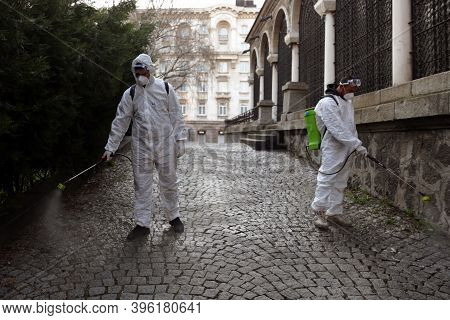 Sofia, Bulgaria - 11 April, 2020: Workers Spray Disinfectant Outside Of Sveta Nedelya Church Against