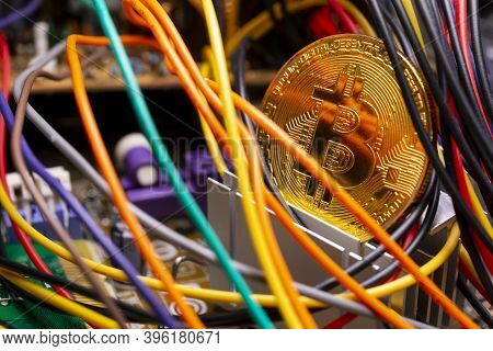 Virtual Cryptocurrency Money Bitcoin Golden Coin On A Computer Printed Circuit Board Pcb Surrounded