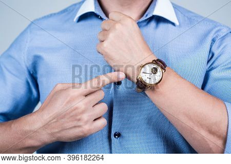 Value Your Time. Manager Cropped View Point Finger At Wrist Watch. Time Management. Meeting Deadline