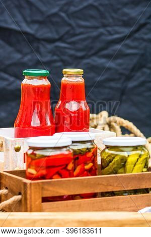 Bottles Of Tomato Sauce, Preserved Canned Pickled Food Concept Isolated In A Rustic Composition.