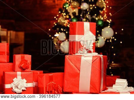 Red Wrapped Gifts Or Presents. Prepare For Christmas And New Year. Wrapping Gifts Concept. Magic Mom