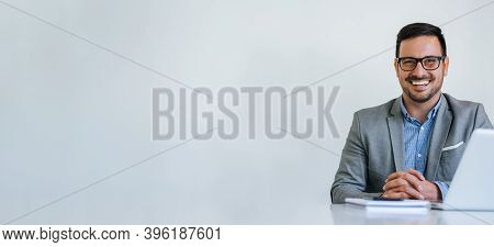 Banner Panorama Portrait Of Young Smiling Cheerful Businessman Manager Entrepreneur With Eyeglasses