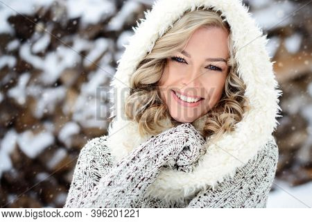 A Beautiful Woman With White Teeth And A Perfect Smile. Happy Sincere Winter Outdoor Portrait Of A Y