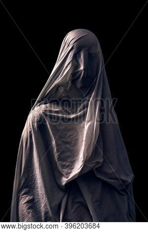 Portrait of a scary ghost isolated on black background