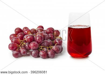 Ripe grapes and glass of fruit juice isolated on white background