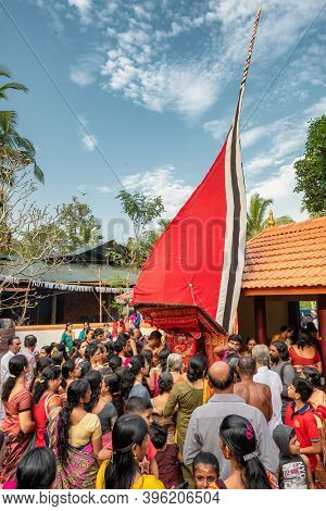 Payyanur, India - December 5, 2019: Theyyam artist perform during temple festival in Payyanur, Kerala, India. Theyyam is a popular ritual form of worship in Kerala, India