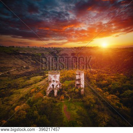 Aerial view at the ruins tower of the Chervonograd castle (Castrum rubrum). Location place Nurkiv village, Ternopil region, Ukraine, Europe. European tourist attraction. Discover the beauty of earth.