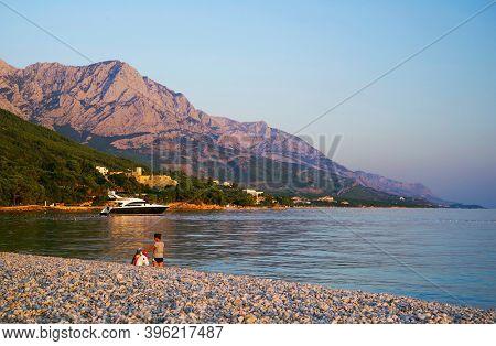 MAKARSKA, CROATIA, 17 SEPTEMBER, 2020: Tourists on the beautiful beach at Adriatic Sea in Makarska Riviera, Dalmatia, Croatia