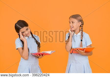 Nervous Kids. Cute Children Reading Book On Yellow Background. Adorable Little Girls Learn Reading C