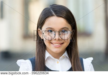 Smart At First Sight. Happy Kid Wear Eyeglasses Outdoors. Sight Test. Eye Examination. Pediatric Oph
