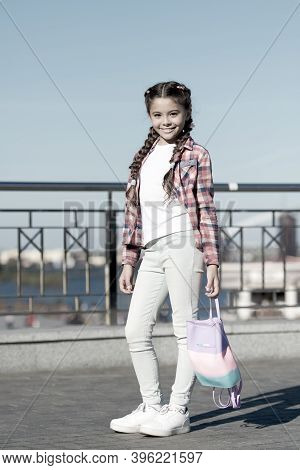 Cute And Stylish. Little Girl With Long Tails Of Hair In Casual Fashion Style. Adorable Girl Of Fash