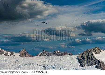 Helicopter Flying Over Franz Josef Glacier As We Hiked The Magnificent Glacier Floor In New Zealand'