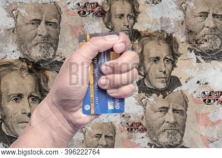 Credit Card In The Hand Of A Man With A Picture Of The Dollar Money On An Old Wall.