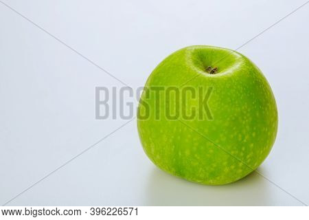 Whole Sour Green Apple Isolated On White Background. Produce Product.