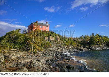 Marquette Harbor light house at Superior lake shore near Marquette city in Michigan upper peninsula