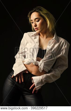 Fashion And Beauty. Female Casual Style. Temptation And Desire. Sensual Girl Isolated On Black. Perf