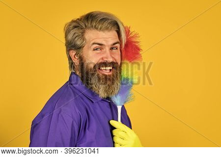 Professional Cleaner. Cleaning Apartment. Hipster Hold Cleaning Tool. Cleaning Concept. Man Use Pp D