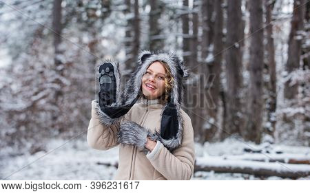 Heartwarming Concept. Animal Care. Winter Themed Portrait Cosy Outfit. Woman Wear Wolf Hat. Animal R