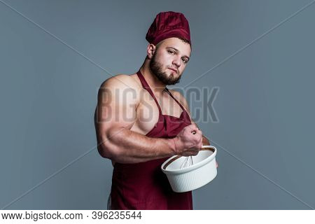 Guy Eating Healthy. Food For Athletes. Sexy Man With Body Muscles In Cook Apron. Professional Handso