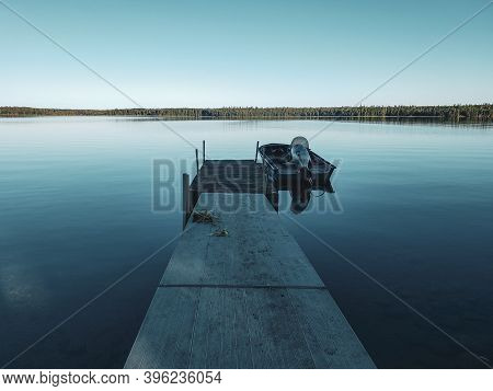 Boat At The End Of The Dock At Sunrise, Child's Lake, Duck Mountain Provincial Park, Manitoba, Canad