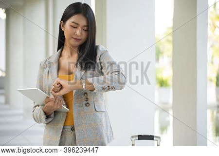 Professional Businessman Seeing Wristwatch To Check Time At Office. Young Businessman Look At Clock