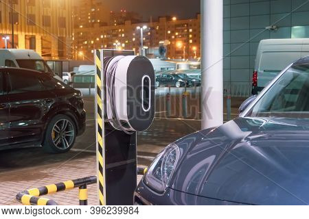 Night Refueling In The City For Electric Cars E-mobility, The Electric Plug Under Voltage Restores T