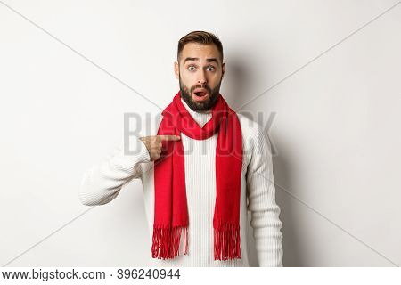 Winter Holidays And Shopping Concept. Surprised And Confused Guy Pointing At Himself, Being Chosen,