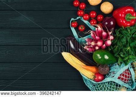 Cotton Bag Full Of Fresh Farm Raw Vegetables From Local Farmer Market, On Black Wooden Background Or