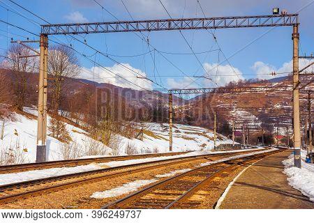 Railway Station In Mountains. Frosty Winter Landscape. Transportation Scenery