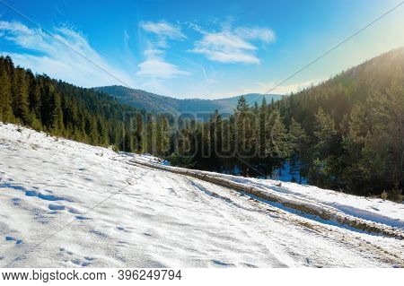 Carpathian Countryside On A Sunny Winter Day. Beautiful Mountainous Rural Landscape. Road Through Sn