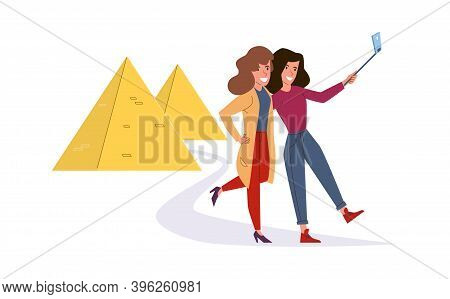 Girls Make Selfie. Cartoon Women Take Pictures Against Background Of Egyptian Pyramids. Excursion To