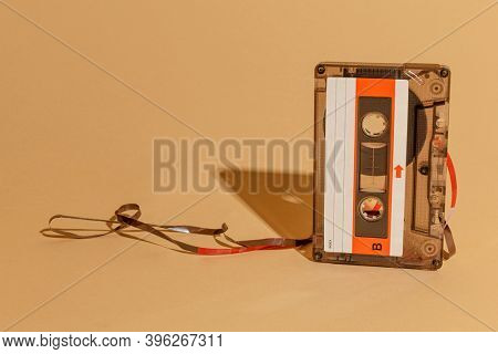 Old school cassette tape on a beige background