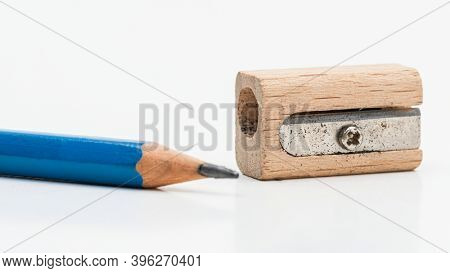 Wooden pencil sharpener with blue pencil