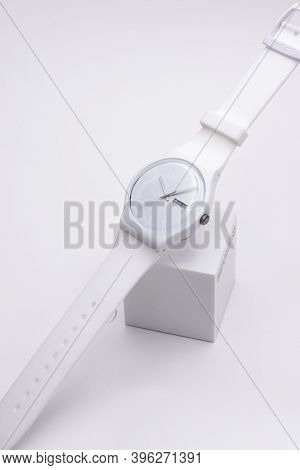 Rome, Italy 07.10.2020 - Swatch Fashion Swiss Made Quartz Watch Close Up On Stand. White Plastic Cas