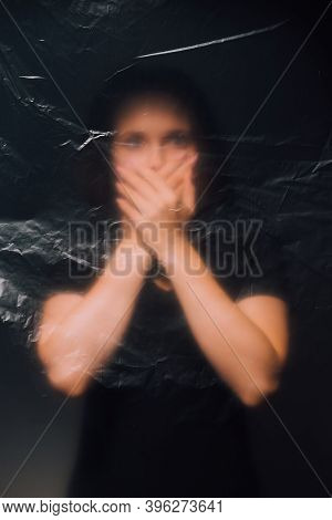 Night Horror. Defocused Female Silhouette. Domestic Violence. Keep Quiet. Family Abuse. Creased Text