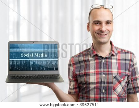 Man With Laptop Computer. Social Media Concept