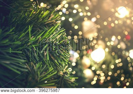 Christmas Concept: Decorated Christmas Tree On Blurred Background