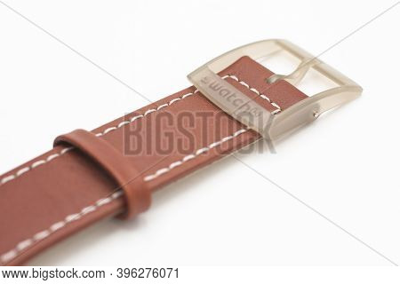 Rome, Italy 07.10.2020 - Swatch Logo On Brown Watch Wrist Strap Of Swiss Made Quartz Watch Isolated