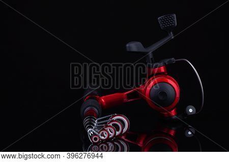 Prague,czech Republic - 9 November,2020: Product Photography Of Red Fishing Rods With Spinning.