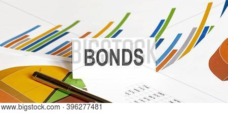 Bonds Text On Paper On The Chart Background With Pen