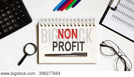 Notebook With Tools And Notes About Non Profit, Business